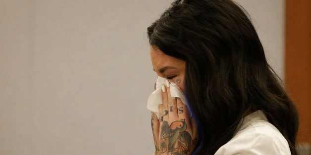 Christine Mackinday, also known as Christy Mack, cries on the witness stand during a preliminary hearing for Jonathan Paul Ko