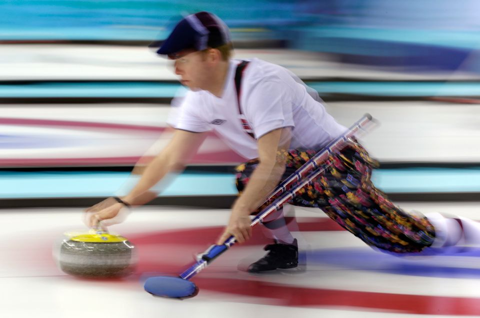 Norway's Torger Nergaard delivers the stone during men's curling training at the 2014 Winter Olympics, Saturday, Feb. 8, 2014