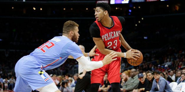 New Orleans Pelicans' Anthony Davis, right, is defended by Los Angeles Clippers' Blake Griffin during the first half of an NB
