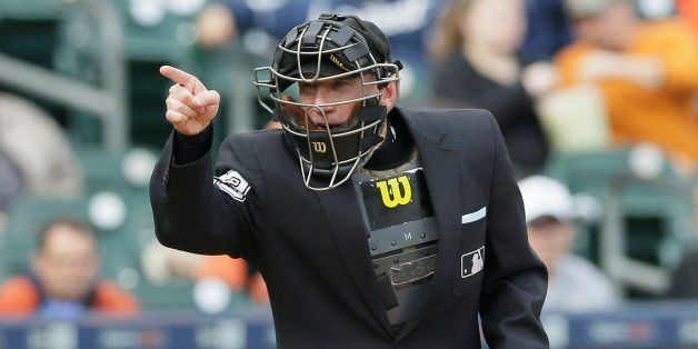 Home plate umpire Lance Barksdale signals during the fourth inning of a baseball game between the Detroit Tigers and the Minn