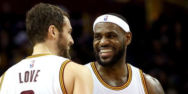 CLEVELAND, OH - DECEMBER 23:  LeBron James #23 and Kevin Love #0 of the Cleveland Cavaliers react after a play in the second