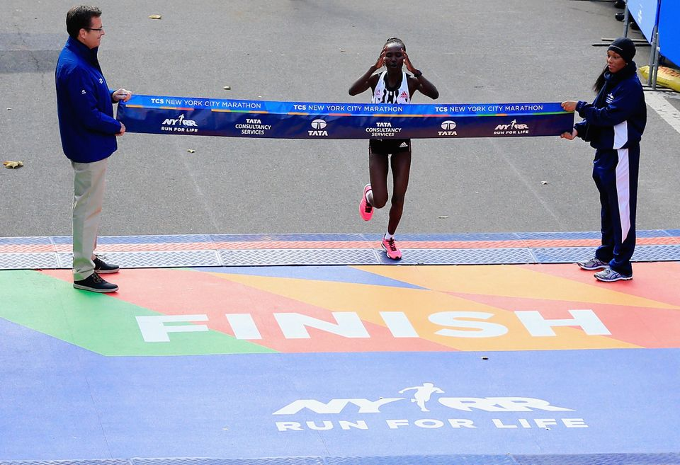 NEW YORK, NY - NOVEMBER 02:  Mary Keitany of Kenya crosses the finish line to win the Pro Women's division during the 2014 TC