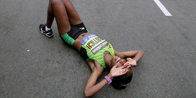 Caroline Rotich, of Kenya, reacts after winning the women's division of the Boston Marathon Monday, April 20, 2015 in Boston.
