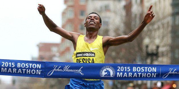 BOSTON, MA - APRIL 20:  Lelisa Desisa of Ethiopa crosses the finish line to win the 119th Boston Marathon on April 20, 2015 i