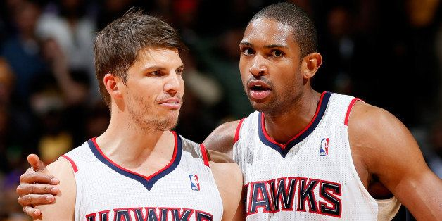 ATLANTA, GA - MARCH 13:  Al Horford #15 of the Atlanta Hawks converses with Kyle Korver #26 prior to his second set of free t