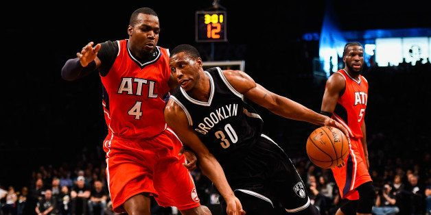 NEW YORK, NY - APRIL 25: Thaddeus Young #30 of the Brooklyn Nets drives past Paul Millsap #4 of the Atlanta Hawks during the