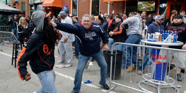 A protestor, left, fights with a bar patron outside of a bar near Oriole Park at Camden Yards after a rally for Freddie Gray,