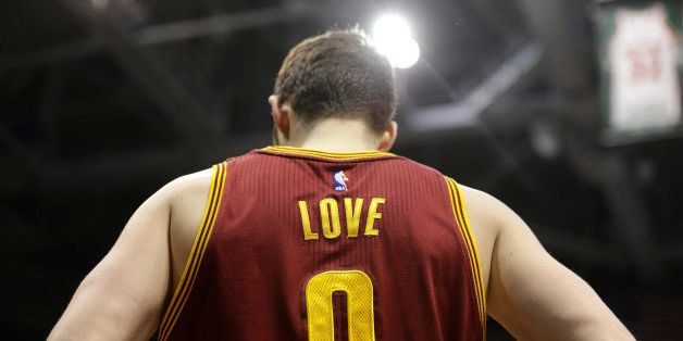 Cleveland Cavaliers' Kevin Love waits to pass the ball in during an NBA basketball game against the Milwaukee Bucks Sunday, M