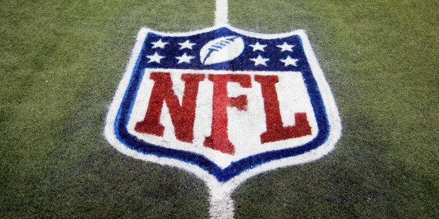 FILE - In this Nov. 20, 2011, file photo, an NFL logo is displayed on the Ford Field turf before an NFL football game between