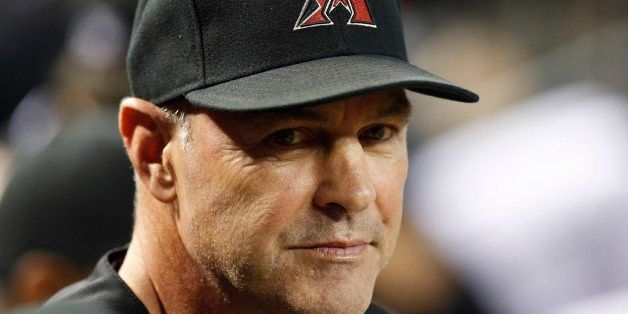 Arizona Diamondbacks' Kirk Gibson waits in the dugout prior to a baseball game against the Pittsburgh Pirates on Saturday, Au
