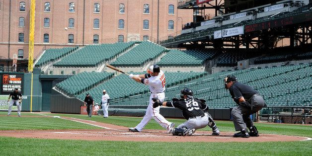 BALTIMORE, MD - APRIL 29:  Chris Davis #19 of the Baltimore Orioles hits a three-run home run in the first inning against the