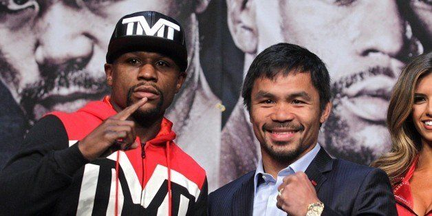 WBC/WBA welterweight champion Floyd Mayweather Jr. (L) and WBO welterweight champion Manny Pacquiao pose during a news confer