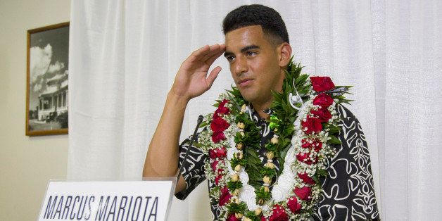 Former Oregon quarterback Marcus Mariota gestures while meeting with the media after being selected in the first round with t