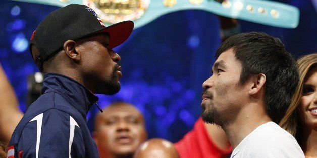 Floyd Mayweather Jr., left, and Manny Pacquiao pose during their weigh-in on Friday, May 1, 2015 in Las Vegas. The world welt
