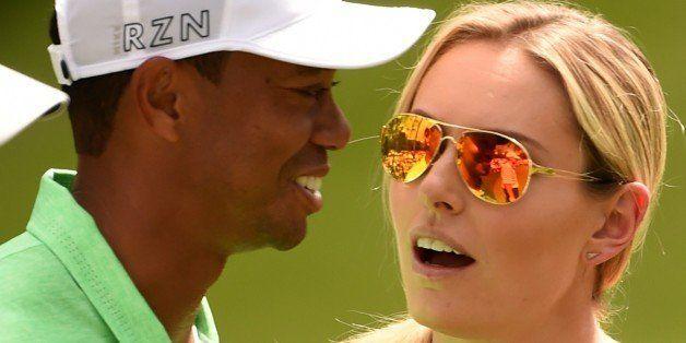 Tiger Woods (L) speaks with US Skier Lindsey Vonn during the Par 3 competition on April 8, 2015, at Augusta National Golf Clu