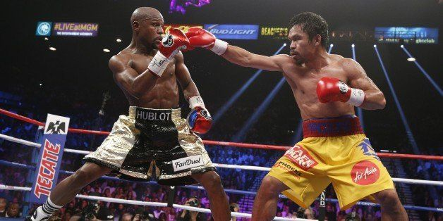 Floyd Mayweather Jr. exchange punches with Manny Pacquiao during their welterweight unification championship bout, May 2, 201