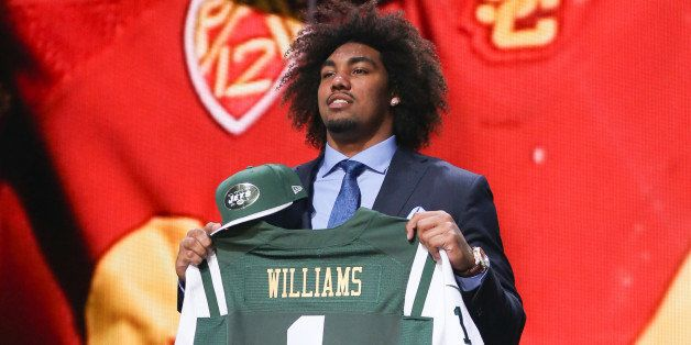 CHICAGO, IL - APRIL 30:  Leonard Williams of the USC Trojans holds up a jersey after being chosen #6 overall by the New York