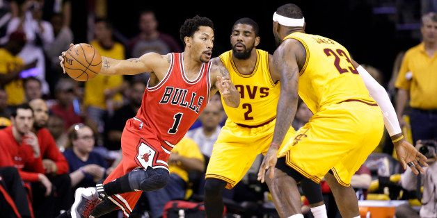 Chicago Bulls guard Derrick Rose (1) drives against Cleveland Cavaliers forward LeBron James (23) and guard Kyrie Irving (2)