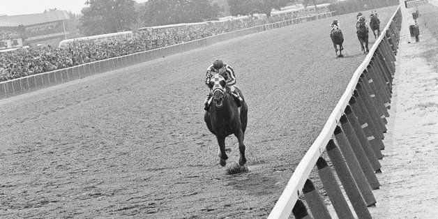 Secretariat, with jockey Ron Turcotte up, leads the field of Belmont Stakes at Belmont Park, Elmont, New York, June 9, 1973 t
