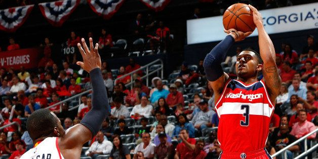 ATLANTA, GA - MAY 05:  Bradley Beal #3 of the Washington Wizards attempts a three-point basket against Paul Millsap #4 of the