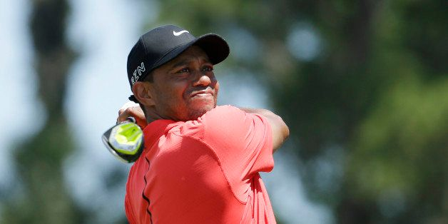 Tiger Woods hits from the 16 tee during the final round of The Players Championship golf tournament Sunday, May 10, 2015, in