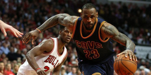 The Cleveland Cavaliers' LeBron James (23) sprints past the Chicago Bulls' Jimmy Butler (21) in Game 6 of the Eastern Confere