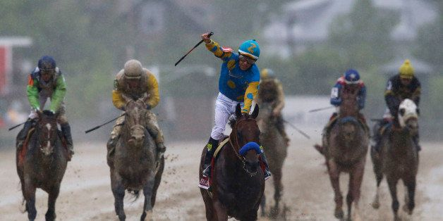 American Pharoah, ridden by Victor Espinoza, center, wins the 140th Preakness Stakes horse race at Pimlico Race Course, Satur