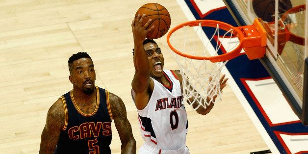 ATLANTA, GA - MAY 20:  Guard Jeff Teague #0 of the Atlanta Hawks gets by guard J.R. Smith #5 of the Cleveland Cavaliers for a