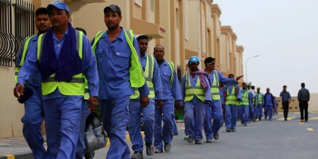 Foreign laborers working on the construction site of the al-Wakrah football stadium, one of the Qatar's 2022 World Cup stadiu