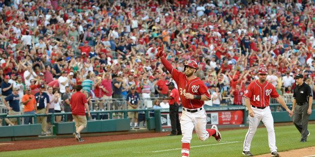Washington Nationals' Bryce Harper gestures as he heads home after he hit a two-run walk-off home run during the ninth inning