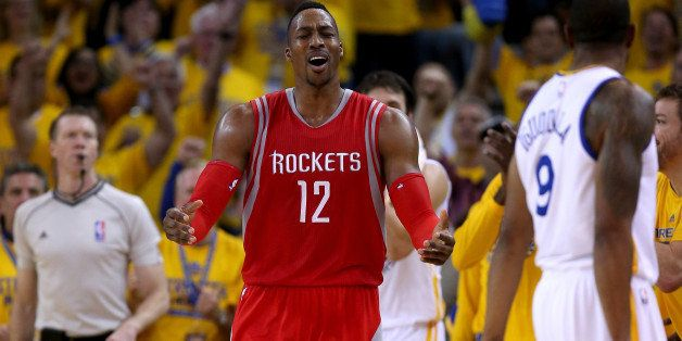 OAKLAND, CA - MAY 27:  Dwight Howard #12 of the Houston Rockets reacts in the second half while taking on the Golden State Wa