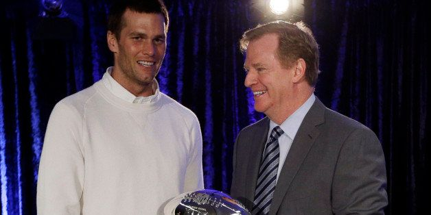 New England Patriots quarterback Tom Brady poses with NFL Commissioner Rodger Goodell during a news conference after the NFL