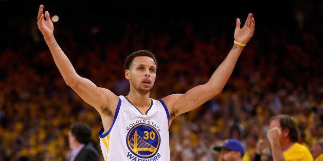 OAKLAND, CA - MAY 27:  Stephen Curry #30 of the Golden State Warriors celebrates late in the fourth quarter against the Houst