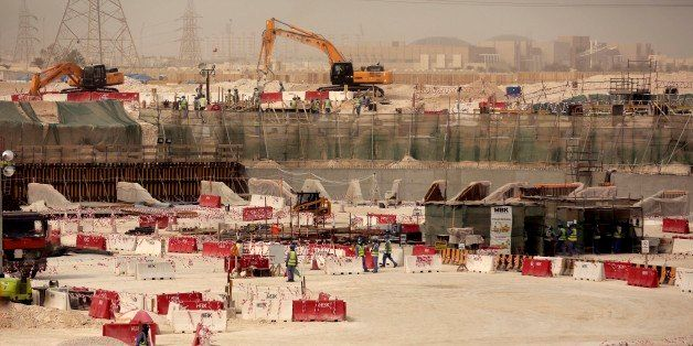 In this photo taken during a government organized media tour, laborers work at the Al-Wakra Stadium that is under constructio