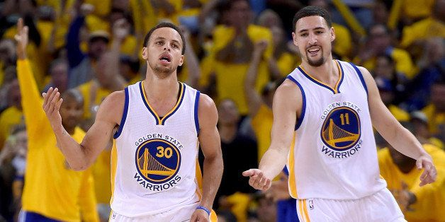 OAKLAND, CA - APRIL 20:  Stephen Curry #30, and Klay Thompson #11 of the Golden State Warriors reacts after Curry hit a jump