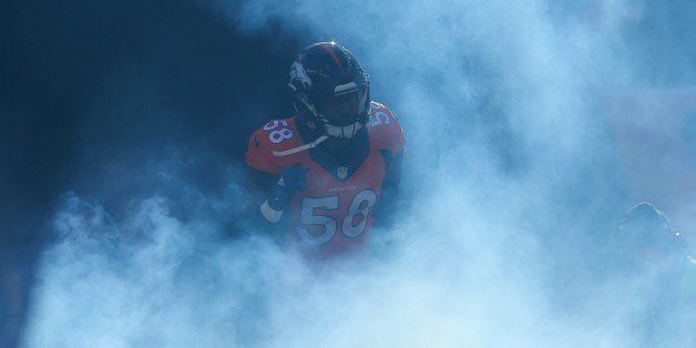 DENVER, CO - DECEMBER 28:  Outside linebacker Von Miller #58 of the Denver Broncos emerges from the tunnel during player intr