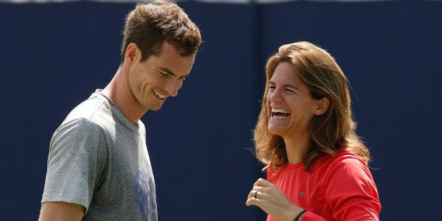 Andy Murray of Britain shares a laugh with his new coach Amelie Mauresmo during a training session before his Queen's Club gr