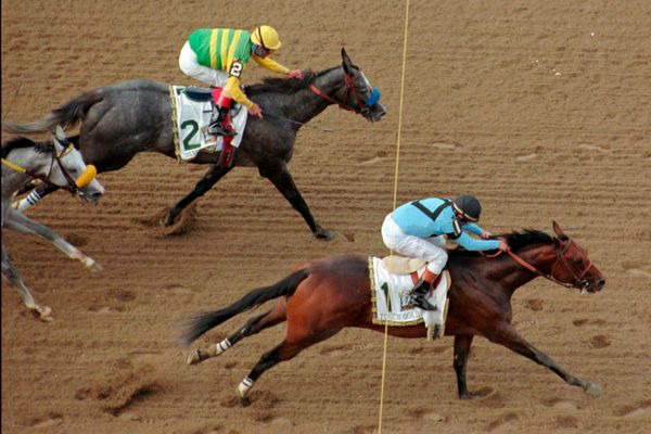 Touch Gold and jockey Chris McCarron, bottom, pass Silver Charm and jockey Gary Stevens, top, and Free House, left, to win th