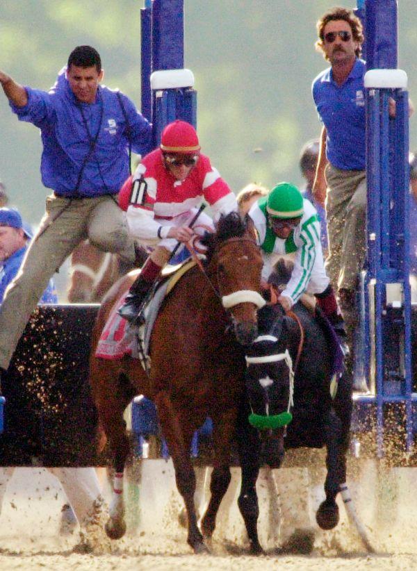 FILE - In this June 8, 2002, file photo, War Emblem and jockey Victor Espinoza, right, stumble into Magic Weisner and jockey