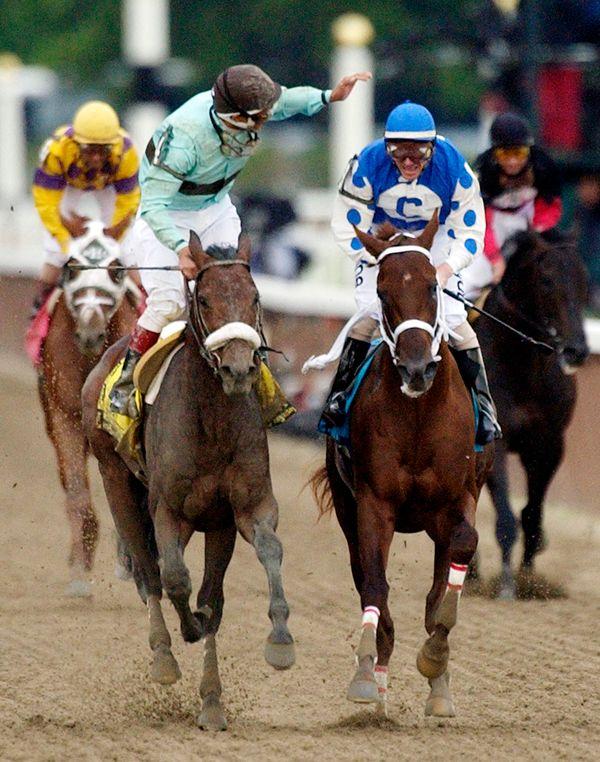 FILE - In this June 5, 2004, file photo, jockey Edgar S. Prado, left, aboard Birdstone, reacts after winning the Belmont Stak