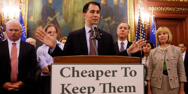 Wisconsin Gov. Scott Walker talks about a deal to pay for a new arena for the Milwaukee Bucks at a news conference Thursday,