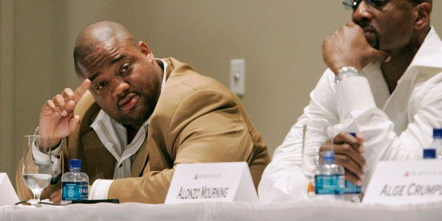 Journalist Jason Whitlock, left tries to get a word in as former NBA all star Alonzo Mourning listens during a panel discussi