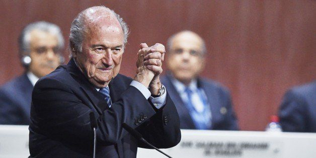 FIFA President Sepp Blatter gestures after being re-elected following a vote to decide on the FIFA presidency in Zurich on Ma