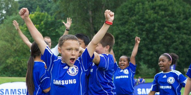COMMERCIAL IMAGE -  Campers from Seattle-area Boys and Girls Clubs celebrate a goal during he Samsung-Chelsea FC Youth Footba