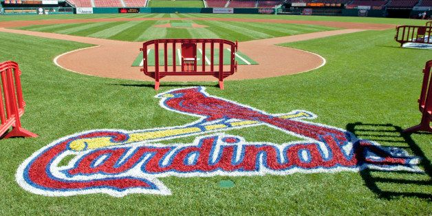 A freshly painted St. Louis Cardinals logo adorns the grass behind home plate Friday, Oct. 6, 2006  at Busch Stadium in St. L