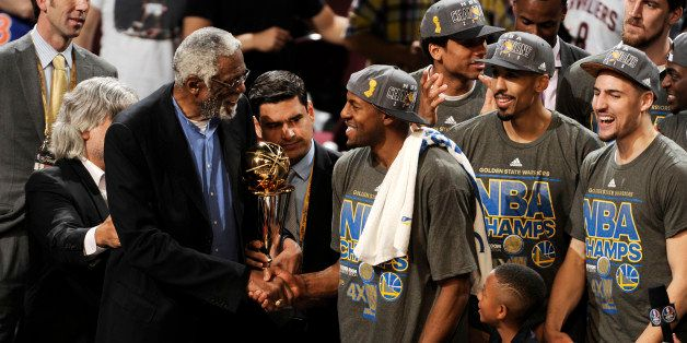 CLEVELAND, OH - JUNE 16: Bill Russell and Andre Iguodala #9 of the Golden State Warriors shake hands after he receives the 20