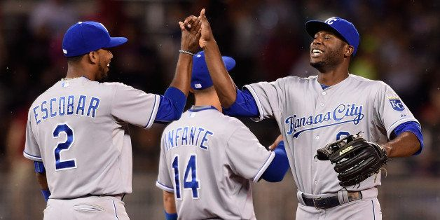 MINNEAPOLIS, MN - JUNE 10: Alcides Escobar #2, Omar Infante #14 and Lorenzo Cain #6 of the Kansas City Royals celebrate a win