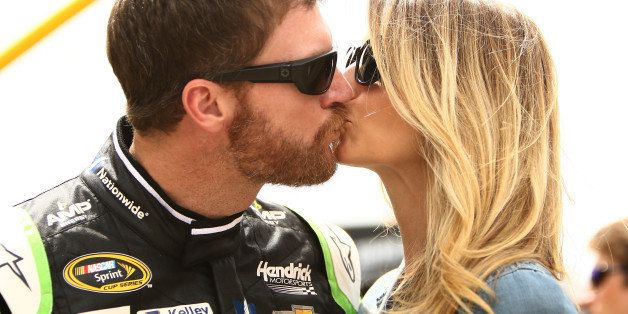 BROOKLYN, MI - JUNE 14:  Dale Earnhardt Jr., driver of the #88 AMP ENERGY Chevrolet, kisses his girlfriend Amy Reimann prior