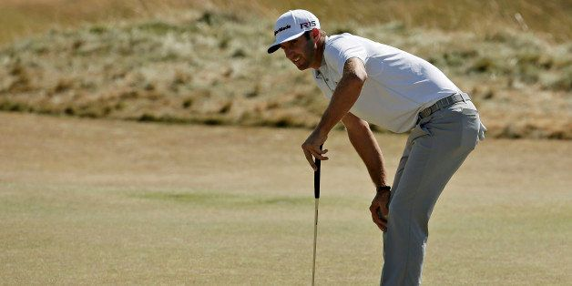 Dustin Johnson reacts to his putt on the sixth hole during the final round of the U.S. Open golf tournament at Chambers Bay o
