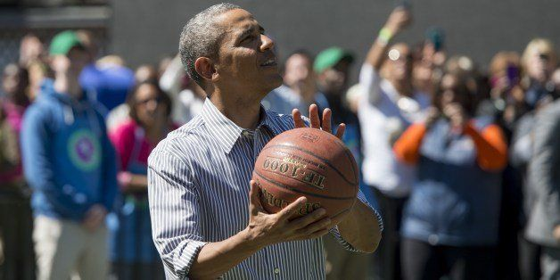 US President Barack Obama shoots a basketball during the annual White House Easter Egg Roll on the South Lawn of the White Ho